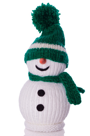 knitted: snowman with green hat and scarf