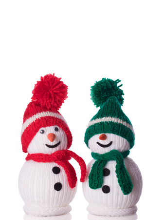 couple of snowman with red and green hat and scarf Imagens
