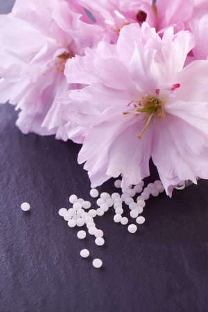 globule: homeopathic globule with pink blossom Stock Photo