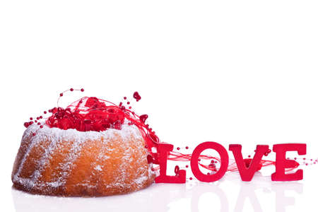 bundt cake with sweet raspberry and love sign Stock Photo