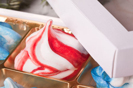 sweet handmade white red meringue swirls Stock Photo