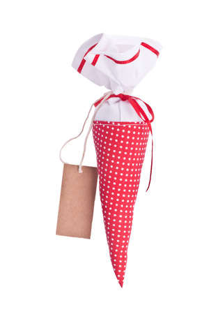 goodie: traditional red goodie cornet for first school day Stock Photo