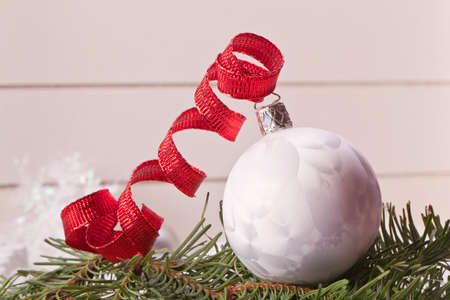 white christmas ball with red ribbon Stock Photo