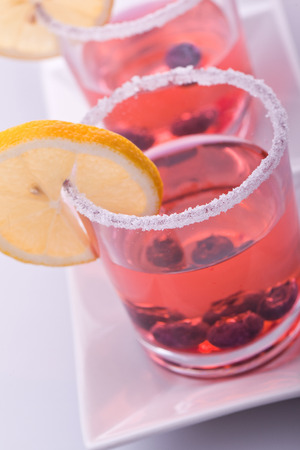 sweet red refreshing lemonade with citrus