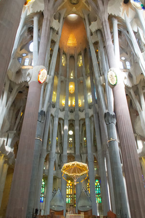BARCELONA, SPAIN - MARCH 12, 2016: The interior of La Sagrada Familia. Designed by Gaudi, the cathedral is being build since 19 March 1882 and is still under construction