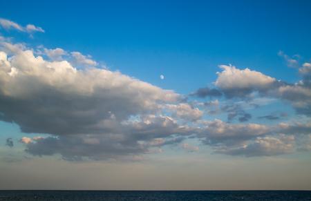 Moon on Blue cloudy sky