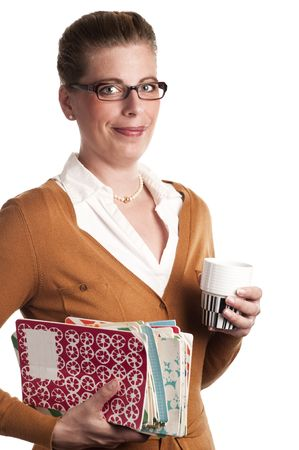 Attractive teacher carries books and a cup of coffe on white background