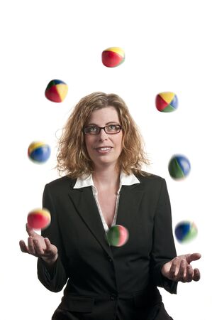 A businesswoman juggling balls on white background
