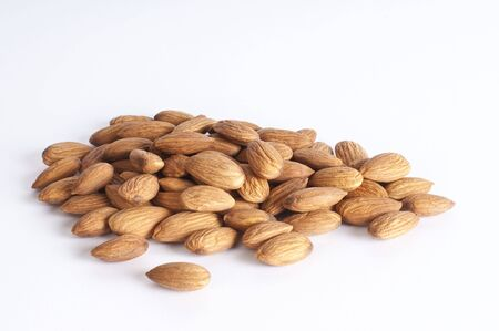 A pile of almonds  on white background with Nikon D300 Stock Photo