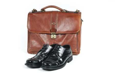 A briefcase and a pair of  shoes symbolizing a salaried employee.