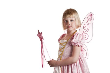 Cute girl dressed up as a fairy on white background