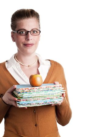 Attractive teacher carries books and an apple on white background