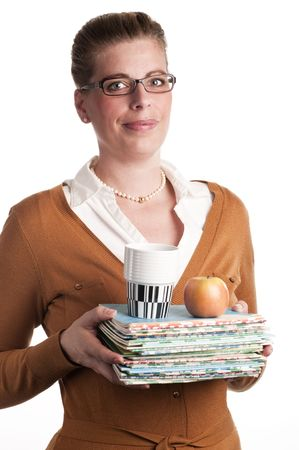 Aantrekkelijke leraar uitoefent boeken, coffe en een appel witte achtergrond Stockfoto