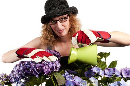 Aantrekkelijke vrouw doet tuinieren met gieter op witte achtergrond Stockfoto