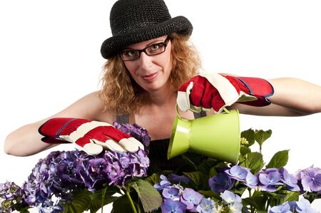 Attractive woman does gardening with watering can on white background Stock Photo