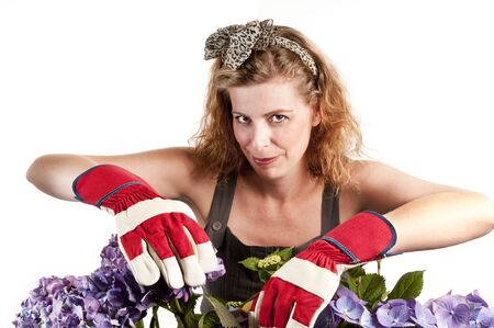 Attractive woman does gardening on white background Stock Photo