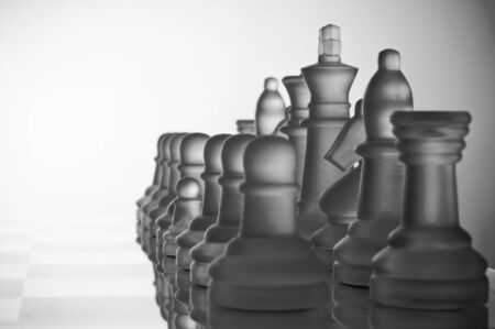 A small pawn with large other chess-pieces Stock Photo