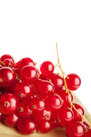 Redcurrants on green dish isolated on white background Stock Photo