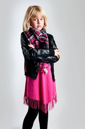 Young girl showing her new cloths, in a fashion way