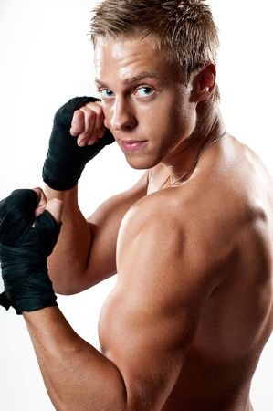 Kickboxing male with guard up isoleted on white background