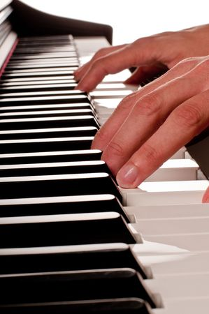 Human hands playing the piano on white background