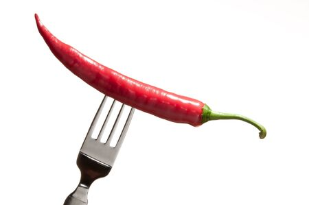 A chili fruit on a fork