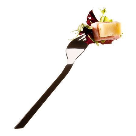 sallad: Ham and cheese sallad on a fork isolated on white