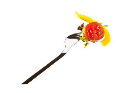 Tomato and pepper on a fork isolated on white