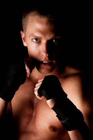 Young fighter male holding guard Stock Photo