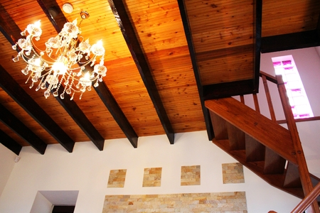electrolier: Wooden ceiling, staircase and elegant electrolier
