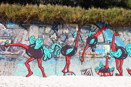 saturated color: Graffiti on the beach wall
