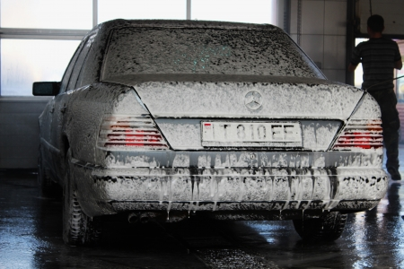 Car washing white foam on a Mercedes Benz
