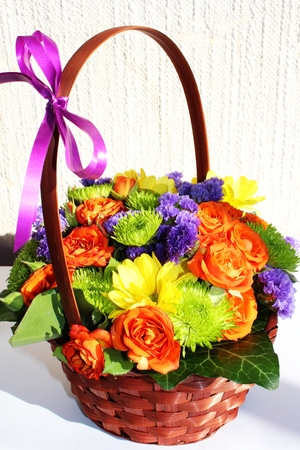 ikebana: Bright flower arrangement  ikebana  in a basket