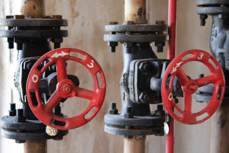 flanges: Gas gate valve red hand-wheel Stock Photo