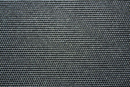 synthetic: Black synthetic textile background Stock Photo