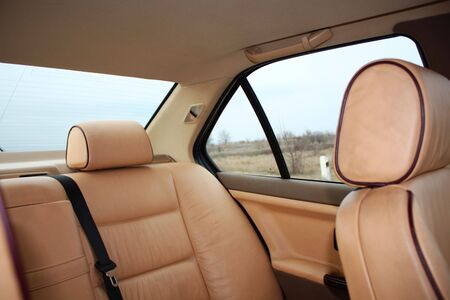 armrest: Rear cream leather vehicle seats