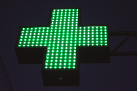 neon green: Neon green cross sign