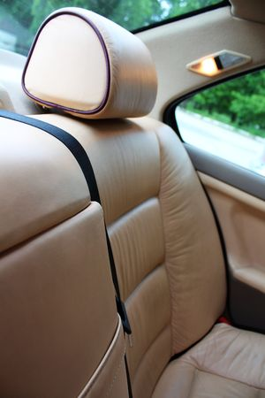 vehicle seat: Cream colour leather vehicle seat