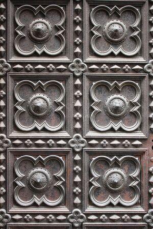 Openwork metallic door