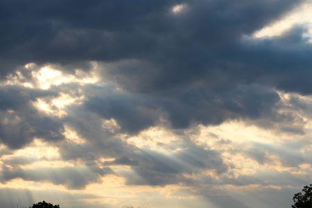 Sun behind the cloud Standard-Bild
