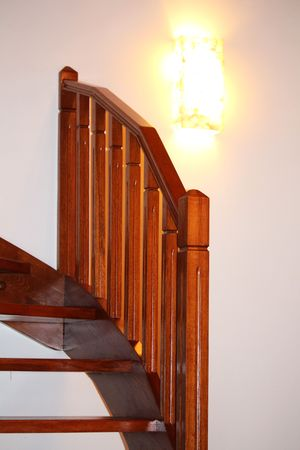 Red wooden oak staircase Standard-Bild