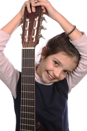 Young girl and guitar on a white background