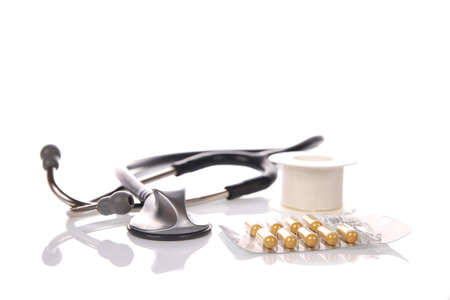 Stethoscope and medication Standard-Bild