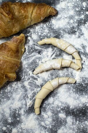 Uncooked croissants ready for baking