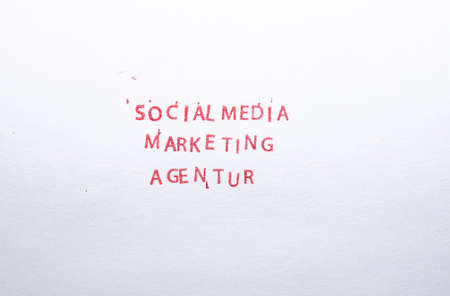 Social Media red stamped letters on white paper