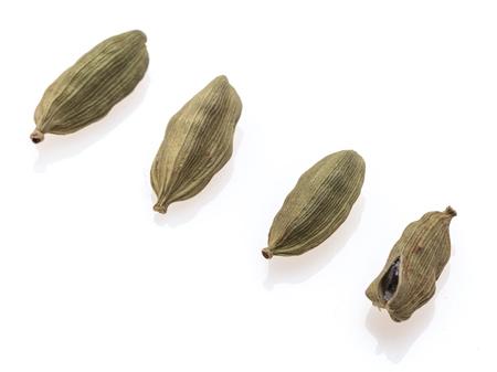 Four pod of cardamom on white background
