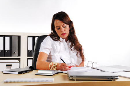 merchandiser: woman is writing and to sit on a desk