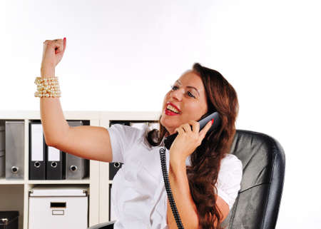 merchandiser: woman to cheer with uplifted arm in the office