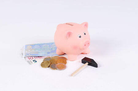 canny: pink Piggy bank with Hammer Euro bills and Euro coins Stock Photo