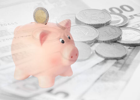 piggy bank with euro background Stock Photo